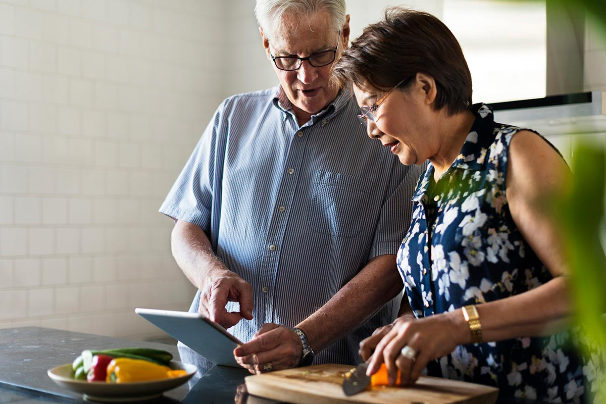 Photo of Senior couple cooking together